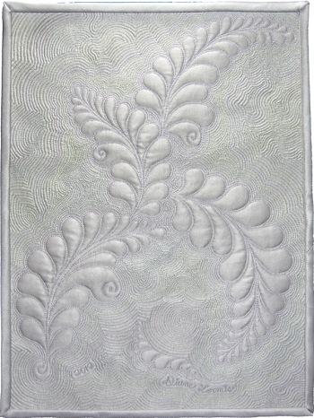 Rogue Feathers a free motion quilted sampler on silver silk by Diane Loomis
