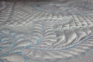 sneak peek at silver feathers on the Silver Anniversay Quilt Challenge for the NEQM by Diane Loomis